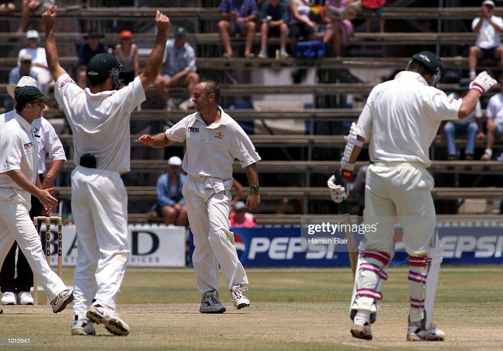 Colin Miller (centre) of Australia is congratulated by team mates after trapping Trevor Gripper of Zimbabwe LBW, during day four of the one off test match between Zimbabwe and Australia at Harare Sports Club, Harare, Zimbabwe.X MandatoryCredit: Hamish Blair/ALLSPORT