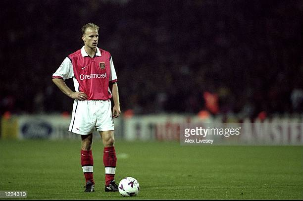 Dennis Bergkamp of Arsenal lines up a freekick during the UEFA European Champions League Group B match against Fiorentina played at Wembley Stadium...