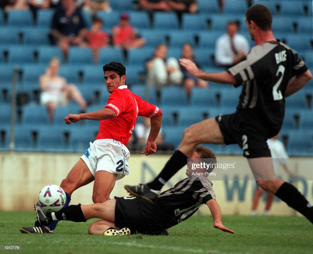Dino Mennillo of the Kingz and Ray Younis of United fight for the ball during the match between Sydney United v Auckland Kingz at the Sydney United sports centre,Sydney Australia.Sydney United won 2-1. Mandatory Credit: Adam Pretty/ALLSPORT