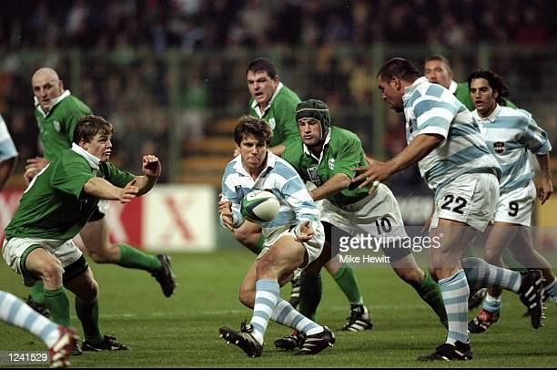 Eduardo Simone passes to Argentinian team mate Martin Scelzo during the Rugby World Cup Quarter Final PlayOff between Ireland and Argentina from the...
