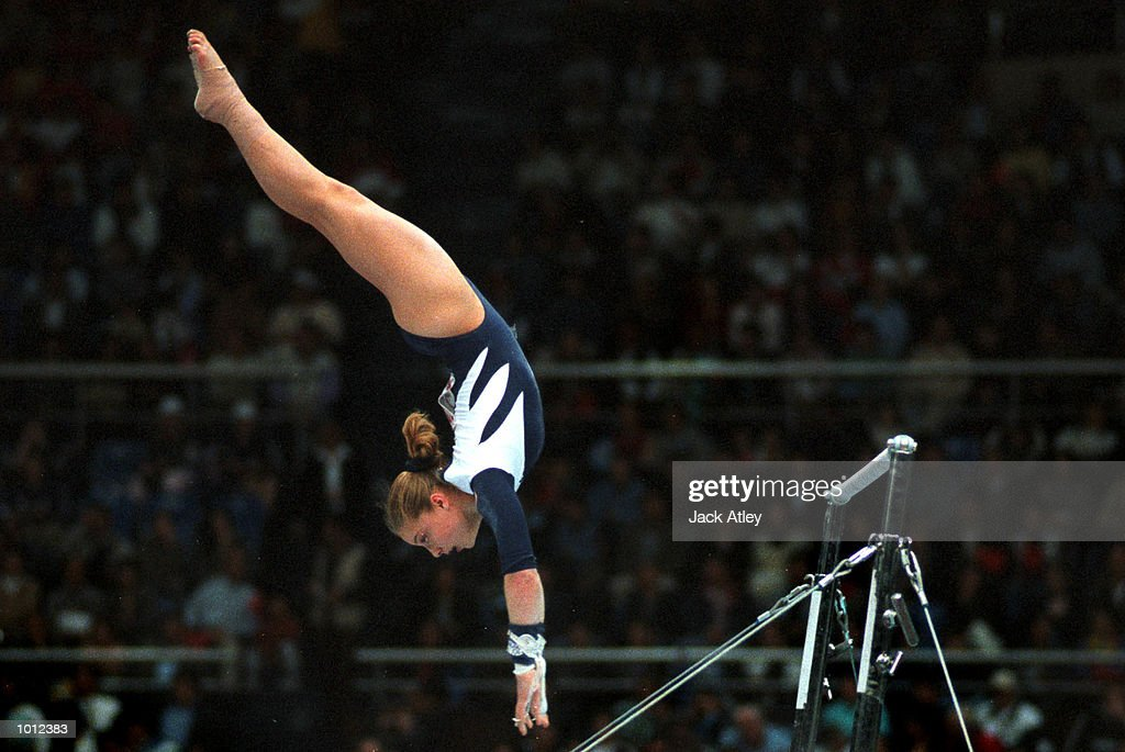 Elise Ray of the United States flies off the uneven bars during the all round individual womens competition final at the 1999 Tianjin World Gymnastics Championships, Tianjin, China. Ray finished in eighth place overall. Mandatory Credit: Jack Atley/ALLSPORT