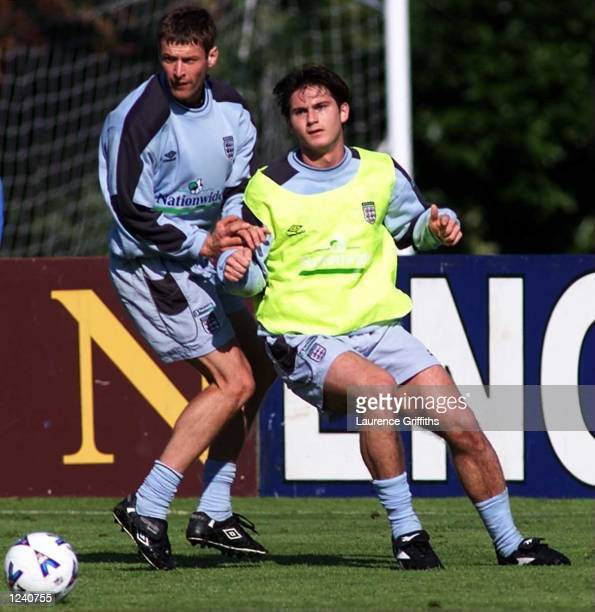 Frank Lampard battles with Chris Sutton during England training in preparation for the friendly against Belgium at Bisham Abbey London Mandatory...