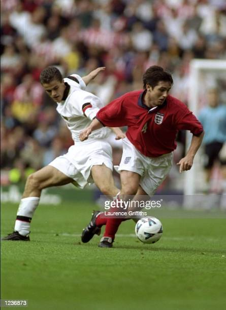 Frank Lampard of England beats David Oyen of Belgium during the International Friendly at the Stadium of Light in Sunderland England England won 21...
