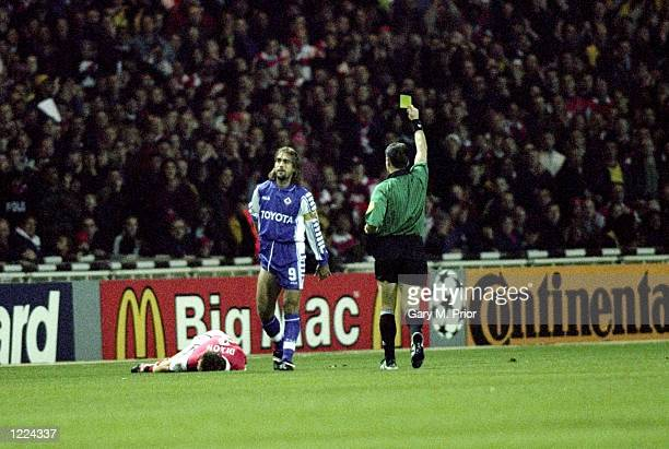 Gabriele Batistuta of Fiorentina is booked during the UEFA European Champions League Group B match against Arsenal played at Wembley Stadium London...