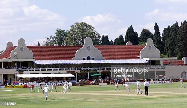General view of Colin Miller of Australia bowling with 'Keg and Maiden' pub in background during day one of the one off test match between Zimbabwe...