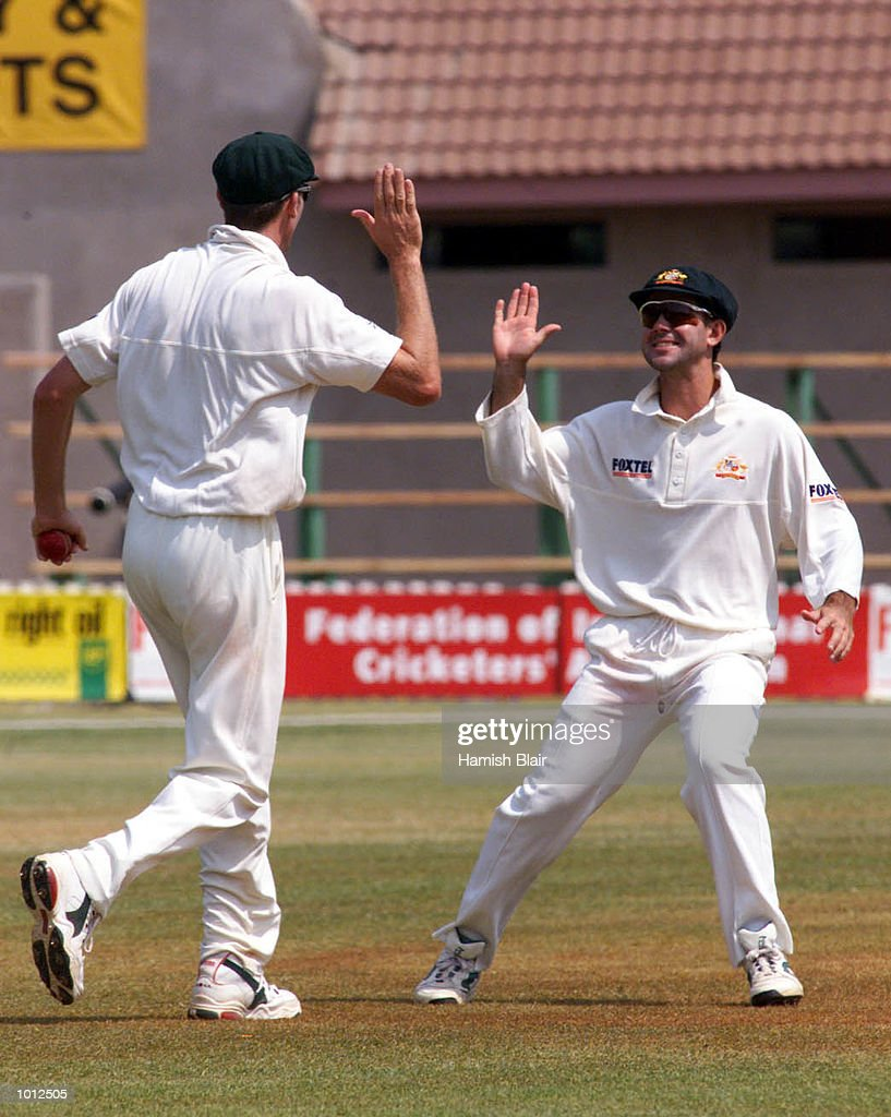 Glenn McGrath (left) and Ricky Ponting of Australia celebrate after McGrath caught Gavin Rennie of Zimbabwe, during day four of the one off test match between Zimbabwe and Australia at Harare Sports Club, Harare, Zimbabwe.X Mandatory Credit: Hamish Blair/ALLSPORT