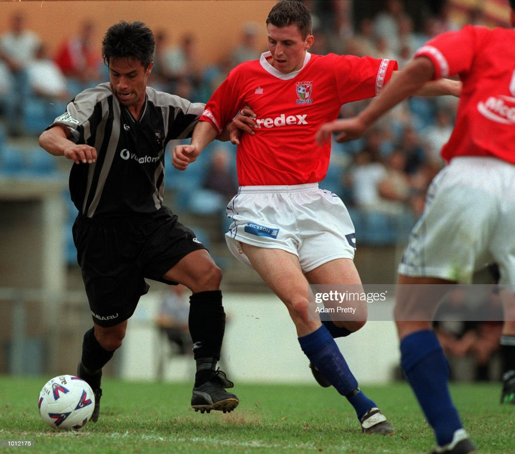 Harry Ngata of the Kingz and Eddie Bosnar of United fight for the ball during the match between Sydney United v Auckland Kingz at the Sydney United sports centre,Sydney Australia.Sydney United won 2-1. Mandatory Credit: Adam Pretty/ALLSPORT