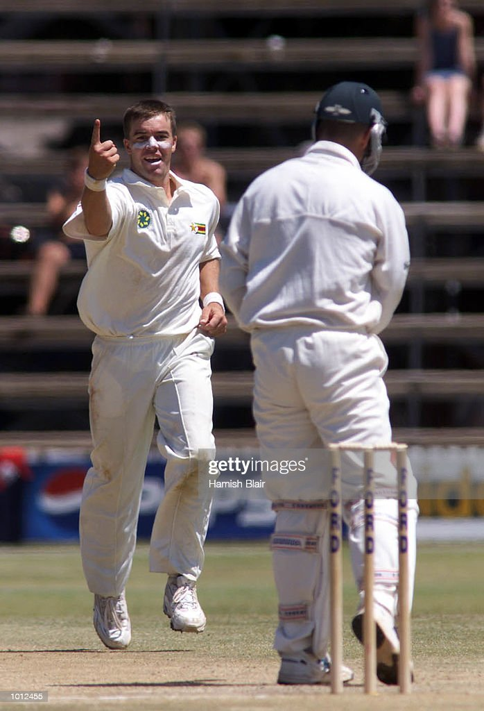 Heath Streak of Zimbabwe celebrates after taking the wicket of Colin Miller of Australia, during day three of the one off test match between Zimbabwe and Australia at Harare Sports Club, Harare, Zimbabwe.X Mandatory Credit: Hamish Blair/ALLSPORT