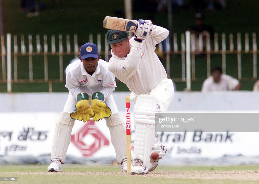 Ian Healy of Australia hits out with Romesh Kaluwitharana of Sri Lanka looking on, on day two of the 3rd Test between Sri Lanka and Australia at Singhalese Sports Club, Colombo, Sri Lanka.X Mandatory Credit: Hamish Blair/ALLSPORT