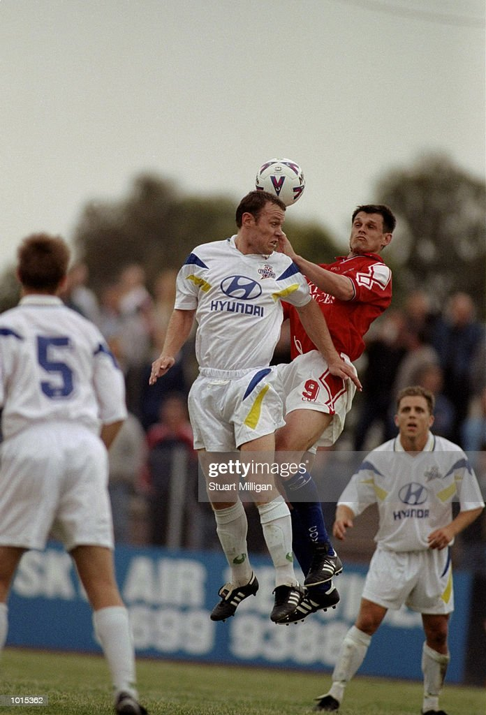 Ivan Kelic #9 of the Melbourne Knights is surrounded by the Brisbane Strikers defenders during the National Soccer League Round 1 match played at Knights Stadium in Melbourne, Australia. The game finished in a 1-0 win for the Brisbane Strikers. \ Mandatory Credit: Stuart Milligan /Allsport