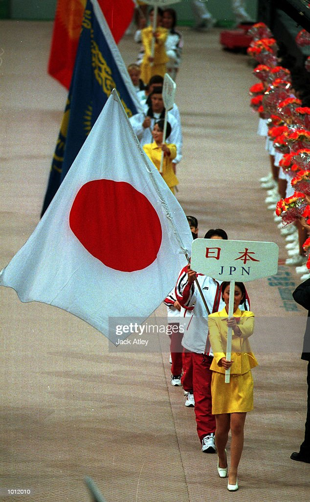 Japan team members enter the main stadium with the national flag during the Opening Ceremony for the 1999 Tianjin World Gymnastics Championships, Tianjin, China. Competition starts tommorrow. Mandatory Credit: Jack Atley/ALLSPORT