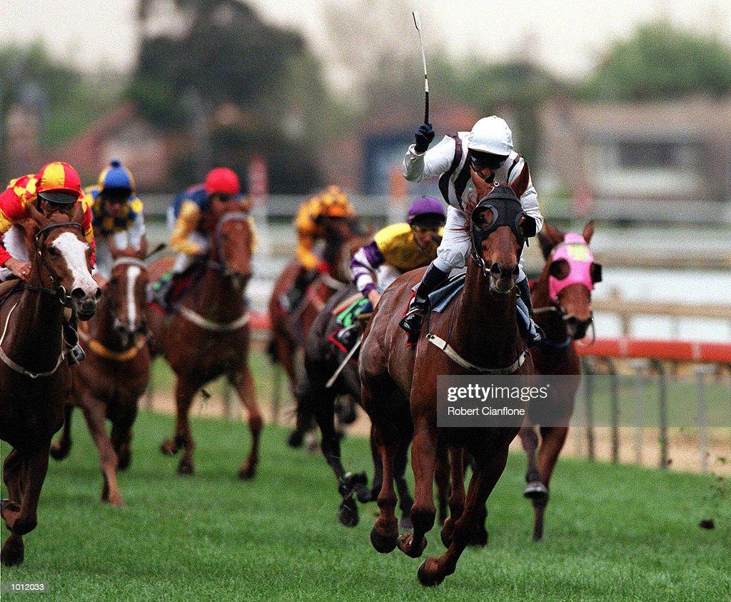 Jockey Eddie Wilkonson takes his horse Umrum to victory in race eight of the Caulfield Guineas at Caulfield Race Course, Melbourne, Australia. Mandatory Credit: Robert Cianflone/ALLSPORT