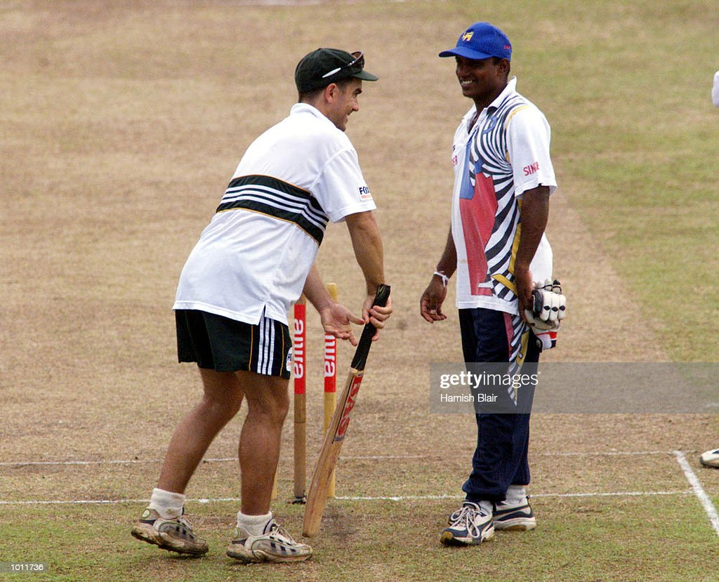 Justin Langer of Australia talks with Aravinda de Silva while a sodden outfield prevents play from starting on time, on day four of the 3rd Test between Sri Lanka and Australia at Singhalese Sports Club, Colombo, Sri Lanka.X Mandatory Credit: Hamish Blair/ALLSPORT