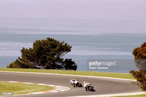 Kenny Roberts Junior of the USA and Alex Criville of Spain in action during the Australian Motorbike Grand Prix at the Phillip Island Circuit in...