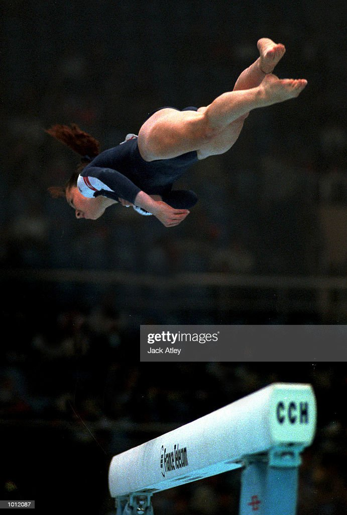 Kristin Maloney of the United Sates flies high during her balance beam routine during the womens qualifying round at the 1999 Tianjin World Gymnastics Championships, Tianjin, China. The United Sates finished fifth overall after the womens qualifying sessions. Mandatory Credit: Jack Atley/ALLSPORT