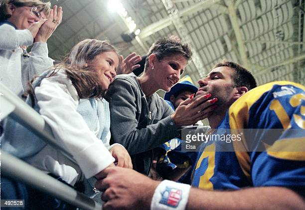 Kurt Warner of the St Louis Rams greets wife Brenda during the game against Cleveland Browns at the Trans World Dome in St Louis Missouri The Rams...