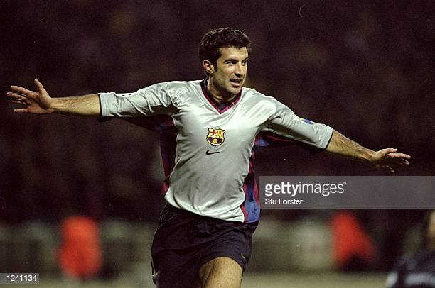 Luis Figo celebrates scoring Barcelona's third goal on 56 minutes during the Champions League Group B match against Arsenal played at Wembley Stadium...