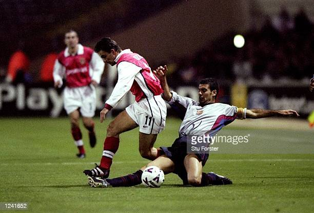 Marc Overmars of Arsenal is tackled by Josep Guardiola of Barcelona during the UEFA Champions League Group B match played at Wembley Stadium London...