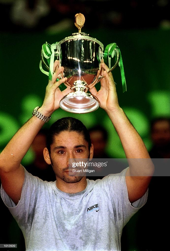 Marcelo Rios of Chile with his trophy after his victory over Mikael Tillstrom of Sweden in the final of the Heineken Singapore Tennis Open, played at the Singapore Indoor Stadium, Singapore. Rios won 6-2, 7-6. Mandatory Credit: Stuart Milligan/Allsport