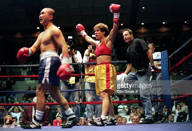 Margaret McGrego celebrates the ring during the fight against Loi Chow at the Mercer Arena in Seattle Washington Mandatory Credit Otto Greule Jr...