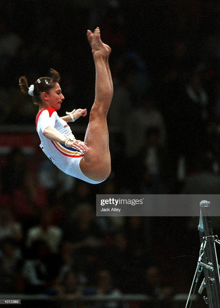 Maria Olaru of Romania flies off the uneven bars during the all round individual womens competition final at the 1999 Tianjin World Gymnastics Championships, Tianjin, China. Olaru won the event overall and was named world champion. MandatoryCredit: Jack Atley/ALLSPORT