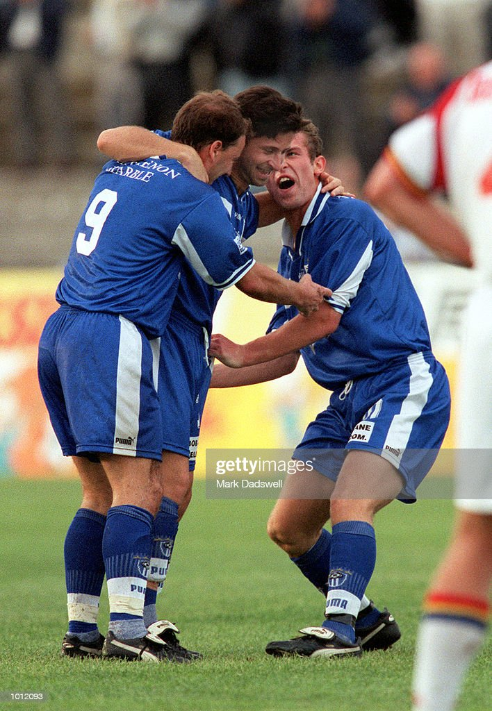 Michael Curcija #10 for South Melbourne (right) celebrates a goal with teammates, during the game South Melbourne versus Northern Spirit, played at Bob Jane Stadium, Albert Park, Melbourne, Australia and won by South Melbourne 2-0. Mandatory Credit: Mark Dadswell/ALLSPORT
