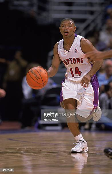 Mugsy Bogues of the Toronto Raptors dribbles the ball down court against the Cleveland Cavaliers at the Air Canada Centre in Toronto Canada The...