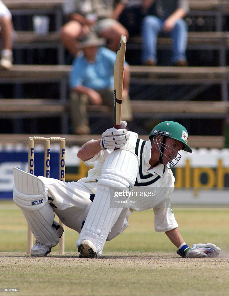 Murray Goodwin of Zimbabwe falls as he ducks under a bouncer from Glenn McGrath of Australia, during day four of the one off test match between Zimbabwe and Australia at Harare Sports Club, Harare, Zimbabwe.X Mandatory Credit: Hamish Blair/ALLSPORT