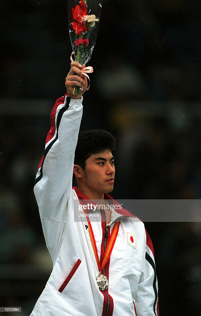 Naoya Tsukahara of Japan salutes the crowd following the all round individual mens competition final at the 1999 Tianjin World Gymnastics Championships, Tianjin, China. Tsukahara finished in second place overall and was awarded the silver medal. Mandatory Credit: Jack Atley/ALLSPORT