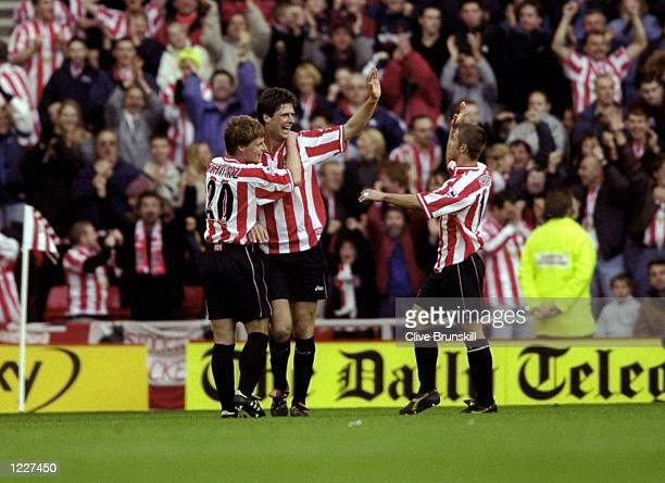 Niall Quinn of Sunderland celebrates his goal against Tottenham Hotspur with team mates Stefan Schwarz and Kevin Phillips during the FA Carling...
