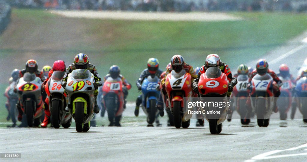 OlivierJacque #19 of France and Jeremy McWilliams #9 of Great Britain lead the field off the start line in the 250cc race at the 1999 Australian Motorbike Grand Prix at Phillip Island, Victoria, Australia. Valentino Rossi of Italy won the race. Mandatory Credit: Robert Cianflone/ALLSPORT