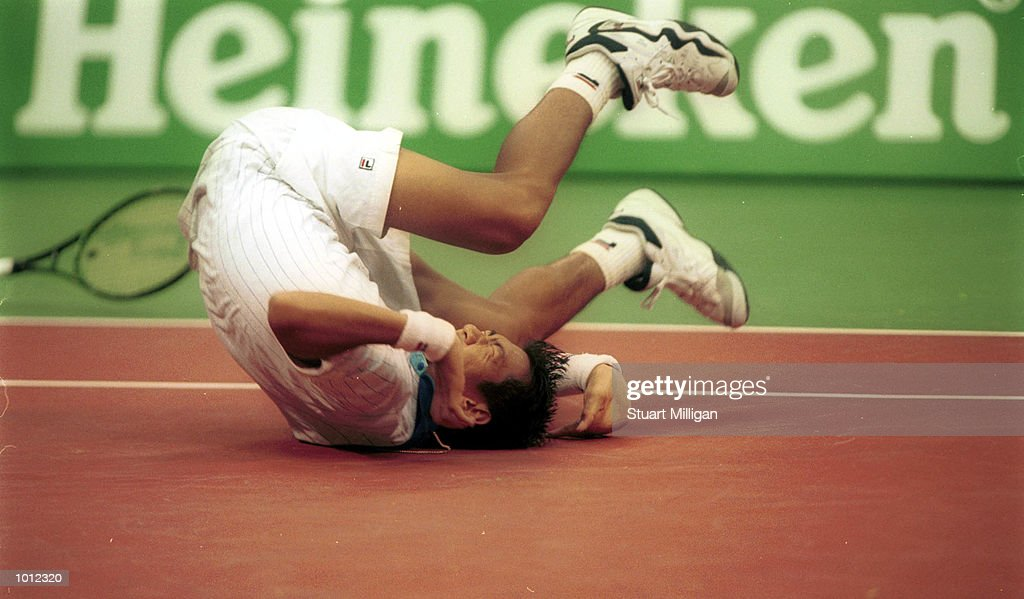 Paradorn Srichaphan of Thailand falls to the ground during his first round match against Magnus Norman of Sweden during the Heineken Singapore Tennis Open, played at the Singapore Indoor Stadium, Singapore. Srichaphan a wild card entrant defeated Norman the third seed 6-3, 1-6,6-3. Mandatory Credit: Stuart Milligan/ALLSPORT