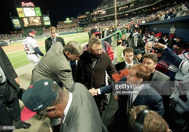 Pete Rose of the All Century Team shakes hands with Commissoner Bud Selig before the World Series game two between the New York Yankees the Atlanta...