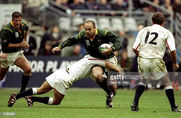 Pieter Muller of South Africa is tackled by Matt Dawson of England in the Rugby World Cup quarterfinal match at the Stade de France in Paris South...