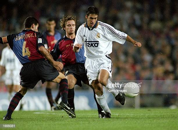 Raul of Real Madrid goes past Josep Guardiola of Barcelona during the Spanish Primera Liga match at the Nou Camp in Barcelona Spain The game ended 22...