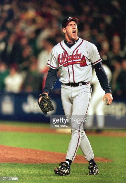 Relief pitcher John Rocker of the Atlanta Braves celebrates as he walks off the field during Game 3 of the National League Championship Series...
