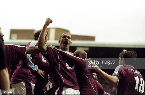 Rio Ferdinand celebrates West Ham United's late equaliser against Sunderland in the FA Carling Premiership match at Upton Park in London The game...