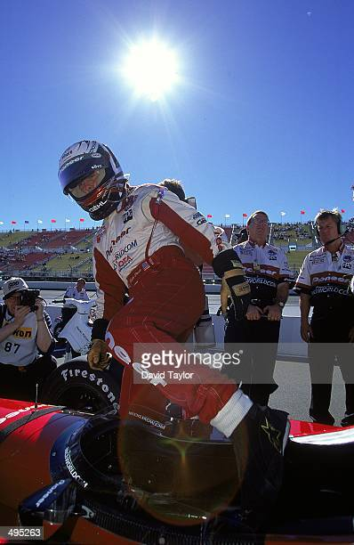 Scott Pruett of the USA who drives a Toyoya Reynard 99I for MCI/ArcieroWells Racing gets into his car during the Marlboro 500 part of the CART FedEx...