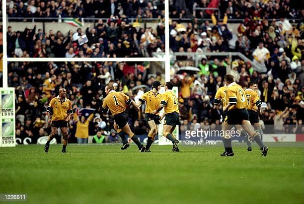 Stephen Larkham of Australia celebrates after kicking a 40m dropgoal during the SemiFinal of the Rugby World Cup against South Africa played at...
