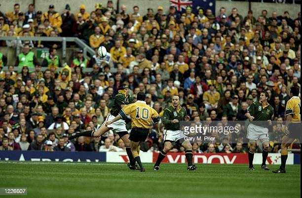 Stephen Larkham of Australia kicks a 40m dropgoal during the SemiFinal of the Rugby World Cup against South Africa played at Twickenham in London...