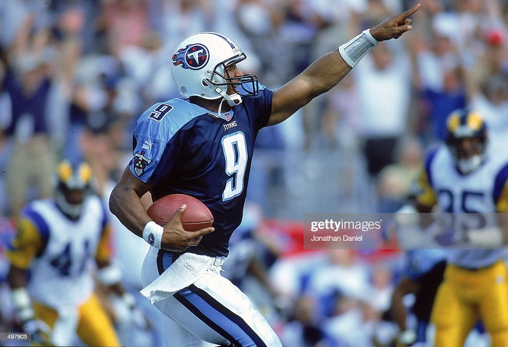 Steve McNair of the Nashville Titans points as he runs with the ball during a game against the St Louis Rams at the Adelphia Coliseum in Nashville...