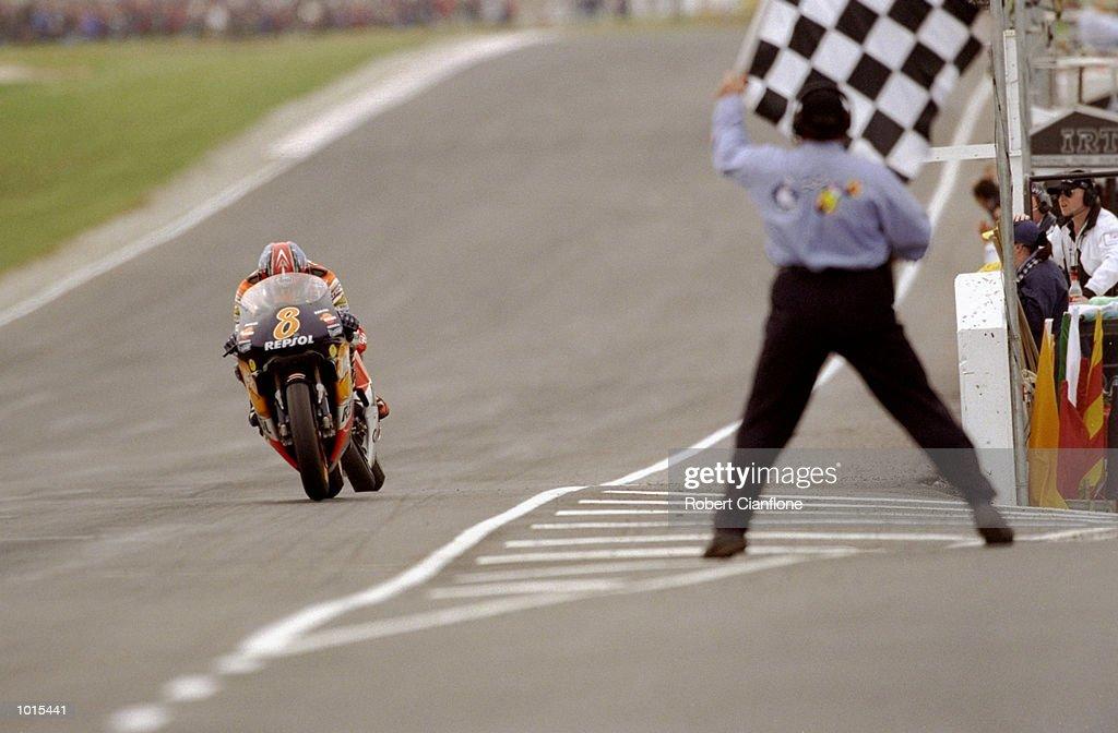 Tadayuki Okada of Japan takes the checkered flag to win the 500cc race at the Australian Motorbike Grand Prix held at Phillip Island in Victoria, Australia. \ Mandatory Credit: Robert Cianflone /Allsport