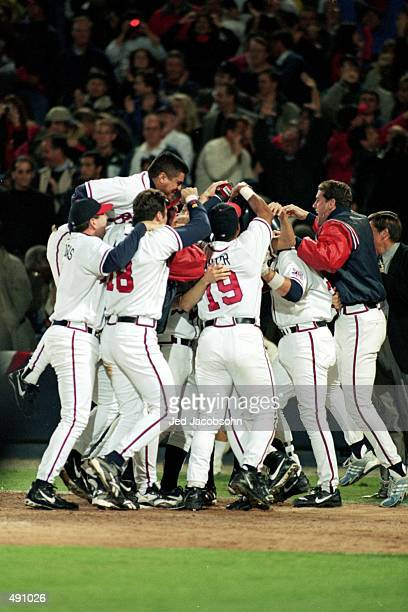 The Atlanta Braves celebrates on the field after winning the National League Championship Series game six against the New York Mets at Turner Field...