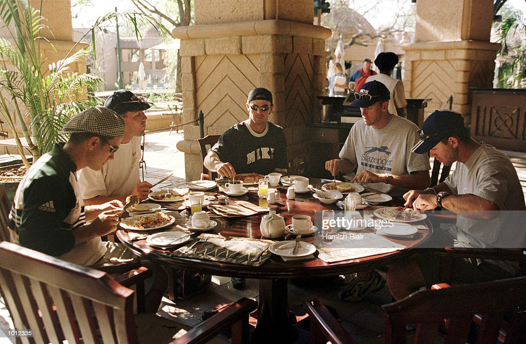 The Australians eat an early morning breakfast after travelling by train overnight from Bulawayo to Victoria Falls, Victoria Falls, Zimbabwe.X Mandatory Credit: Hamish Blair/ALLSPORT