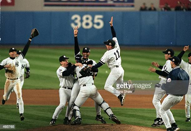The New York Yankees celebrate on the field after winning the World Series Game four against the Atlanta Braves at Yankee Stadium in the Bronx New...
