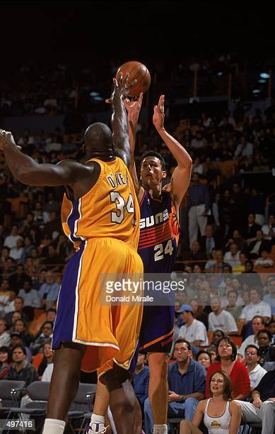 Tom Gugliotta of the Phoenix Suns shoots the ball as Shaquille O''Neal of the Los Angeles Lakers guards him during the game at the Great Western...