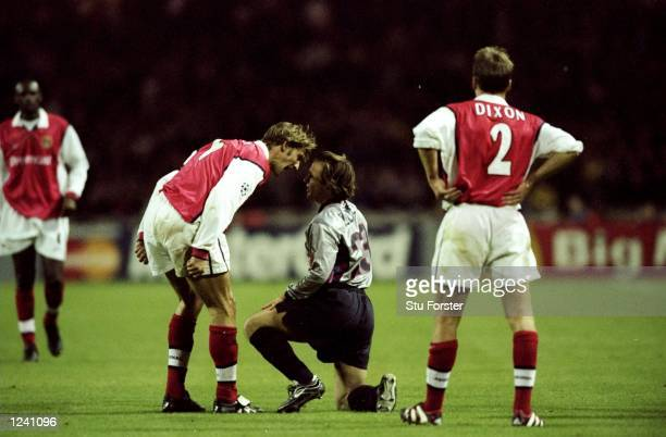 Tony Adams of Arsenal argues with Boudewijn Zenden of Barcelona during the Champions League Group B played at Wembley Stadium London The game...