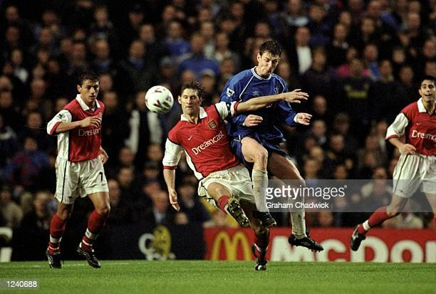Tony Adams of Arsenal battles with Chris Sutton of Chelsea during the FA Carling Premier League match played at Stamford Bridge London The game...