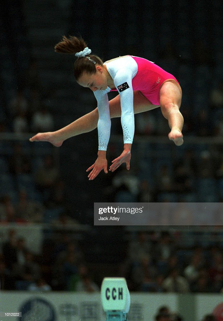 Trudy McIntosh of Australia flies above the balance beam during the qualifying round at the 1999 Tianjin World Gymnastics Championships, Tianjin, China. Mandatory Credit: Jack Atley/ALLSPORT