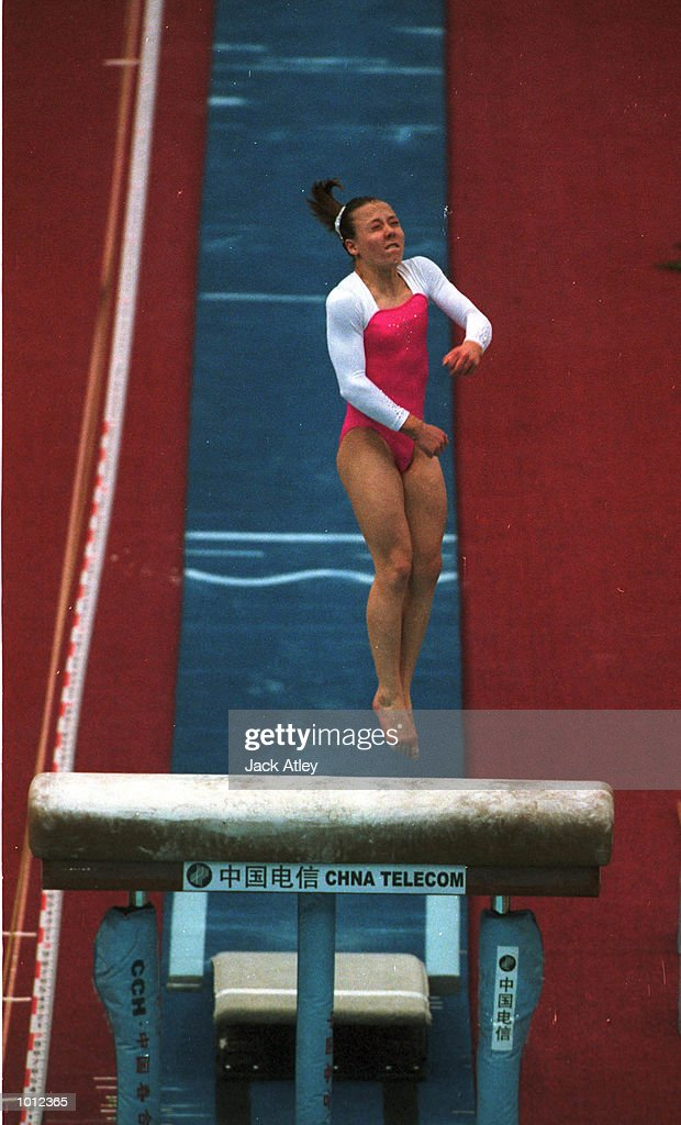 Trudy McIntosh of Australia flies off the vault during the individual womens final at the 1999 Tianjin World Gymnastics Championships, Tianjin, China. Mandatory Credit: Jack Atley/ALLSPORT